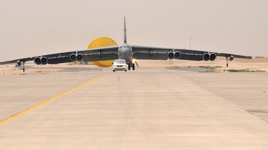 A U.S. Air Force B-52 Stratofortress aircraft from Barksdale Air Force Base, Louisiana, arrives at Al Udeid Air Base, Qatar, Saturday, April 9, 2016. The U.S. Air Force says it has deployed the bombers to take part in the U.S.-led bombing campaign against the Islamic State group. It is the first time the Cold War-era heavy bombers will be based in the region since the 1991 Gulf War, when they operated from neighboring Saudi Arabia. (Staff Sgt. Corey Hook/U.S. Air Force via AP)