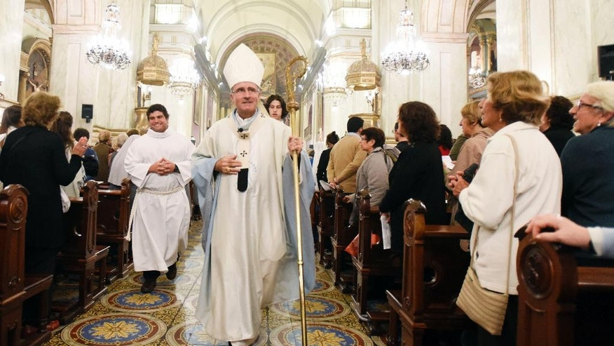 "In this April 4, 2016 photo, Cardinal Daniel Sturla, archbishop of Montevideo, walks down the main aisle of the cathedral, in Montevideo, Uruguay. The Catholic Church recently proposed erecting a statue of the Virgin Mary in a park next to a popular promenade, a debate erupted over whether religious symbols in public places violate the separation between church and state. ""I didn't think there was going to be this kind of resistance,"" Sturla said. ""Our city must be among the few in Latin America and the whole Christian world that don't have a public image of the Virgin."" (AP Photo/Matilde Campodonico)"