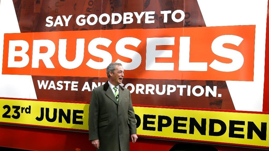FILE- In this Thursday, March 31, 2016 file photo, Nigel Farage, leader of Britain's UKIP party walks past a 'Grassroots Out' advertising lorry outside the Electoral Commission, in London. With less than three months to go until a June 23 referendum, Britain's anti-EU campaigners are bitterly divided, with two rival camps battling over which will be the standard-bearer in the campaign, and over how to win the historic vote. (AP Photo/Kirsty Wigglesworth, File)