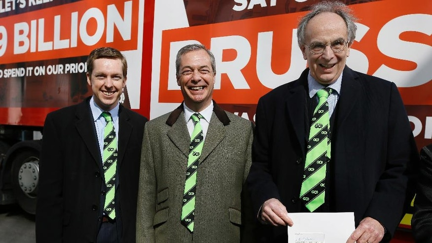 FILE- In this Thursday, March 31, 2016 file photo, Conservative Members of Parliament, Tom Pursglove, left, and Peter Bone, right, stand with Nigel Farage, leader of Britain's UKIP party,  as they hold the application letter outside the Electoral Commission, in London. With less than three months to go until a June 23 referendum, Britain's anti-EU campaigners are bitterly divided, with two rival camps battling over which will be the standard-bearer in the campaign, and over how to win the historic vote. (AP Photo/Kirsty Wigglesworth, File)