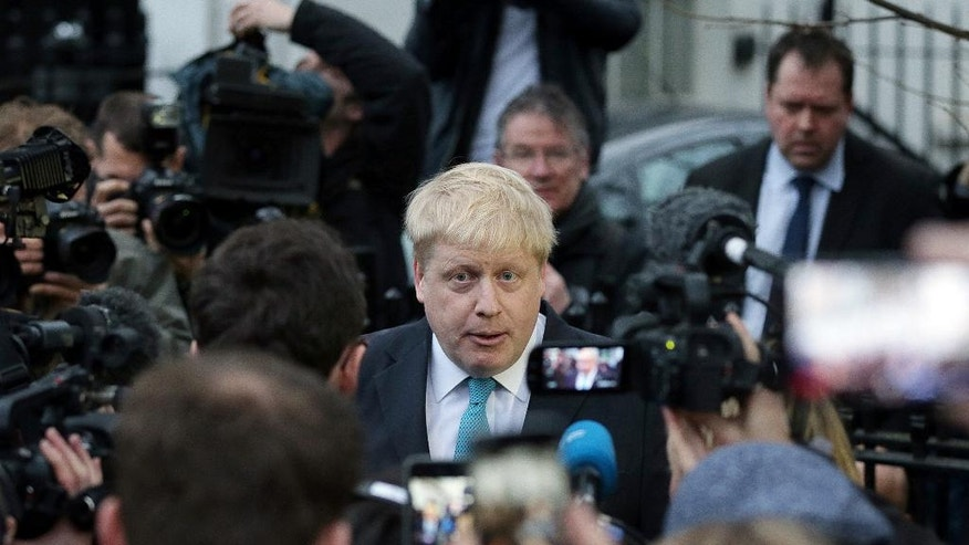 FILE- In this Sunday Feb. 21, 2016 file photo, London Mayor Boris Johnson makes a statement outside his home in London. With less than three months to go until a June 23 referendum, Britain's anti-EU campaigners are bitterly divided, with two rival camps battling over which will be the standard-bearer in the campaign, and over how to win the historic vote. (AP Photo/Tim Ireland, File)