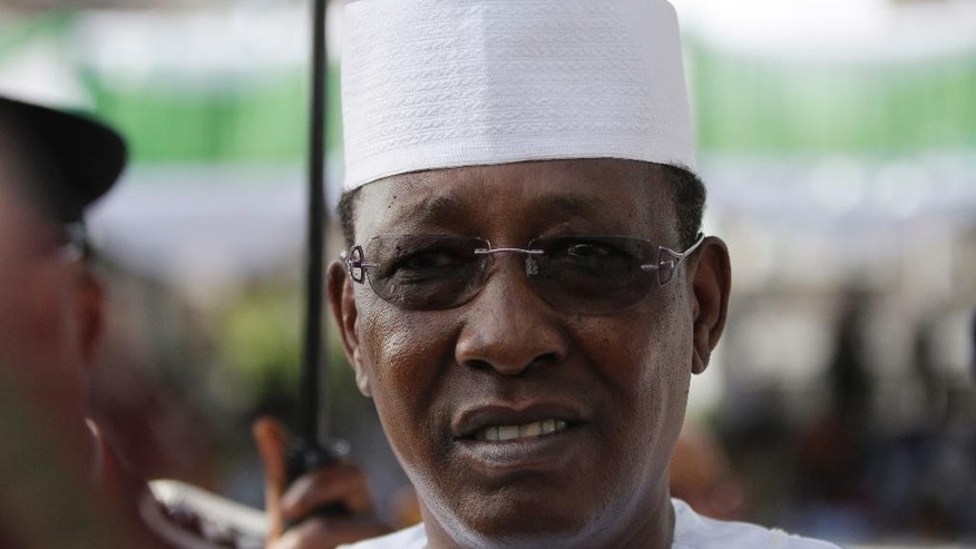 FILE-In this file photo taken on Friday, May 29, 2015, Chadian President Idriss Deby arrives for the inauguration of the new Nigerian President, Muhammadu Buhari,  at the eagle square in Abuja, Nigeria. Chadian President Idriss Deby faced off against more than a dozen challengers Sunday, Apirl 10, 2016,  as he seeks another term after more than 25 years in power in this central African nation which is battling Islamic extremists. (AP Photo/Sunday Alamba, File)