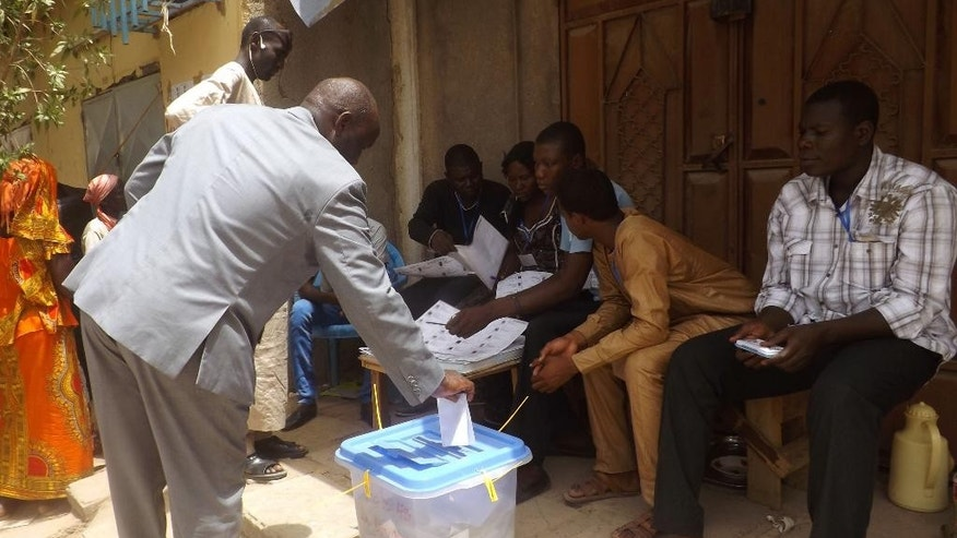 A man casts his ballot during elections in N'Djamena, Chad, Sunday, April 10, 2016. Chadian President Idriss Deby faced off against more than a dozen challengers Sunday as he seeks another term after more than 25 years in power in this central African nation which is battling Islamic extremists. (AP Photo/Abakar Mahamad)