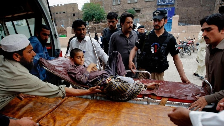 Volunteers transport a boy injured from an earthquake in Peshawar, Pakistan, Sunday, April 10, 2016. A powerful earthquake rattled Pakistan's capital and other cities across the country on Sunday, causing panic among people but with no immediate reports of casualties or major damages. Pakistani official Arif Ullah told The Associated Press that the magnitude-7.1 quake was centered near Afghanistan's border with Tajikistan. (AP Photo/Mohammad Sajjad)