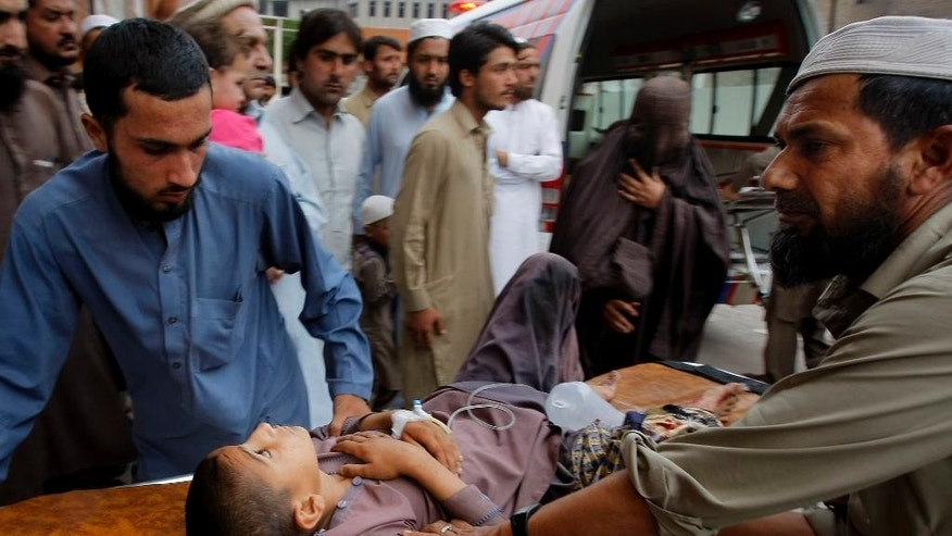 Volunteers transport a boy to a hospital injured from an earthquake in Peshawar, Pakistan, Sunday, April 10, 2016. A powerful earthquake rattled Pakistan's capital and other cities across the country on Sunday, causing panic among people but with no immediate reports of casualties or major damages. Pakistani official Arif Ullah told The Associated Press that the magnitude-7.1 quake was centered near Afghanistan's border with Tajikistan. (AP Photo/Mohammad Sajjad)