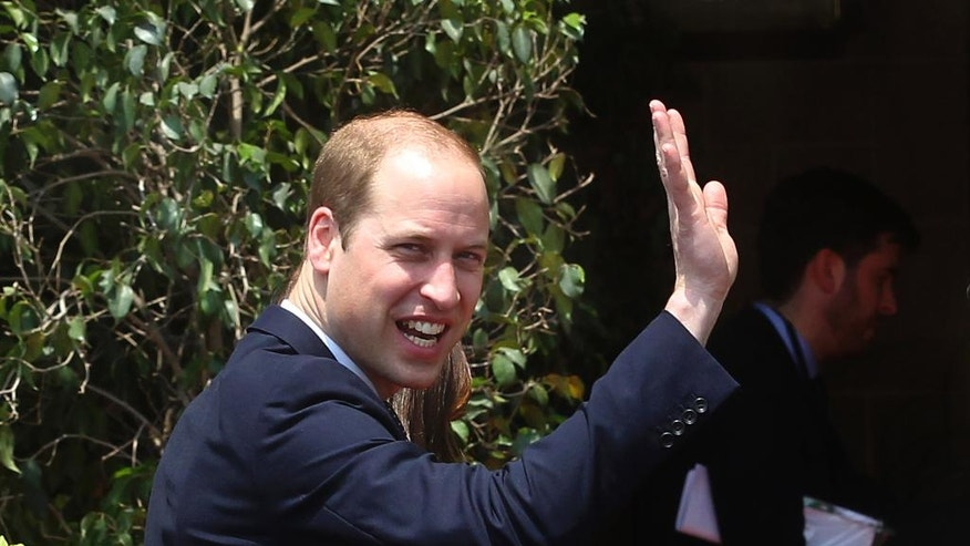 Britain's Prince William waves as he arrives at Hotel Taj in Mumbai, India, Sunday, April 10, 2016. William and Kate, Duchess of Cambridge, visited this iconic hotel which was one of the prime targets of the 2008 terror attacks on the city. (AP Photo/Rafiq Maqbool)
