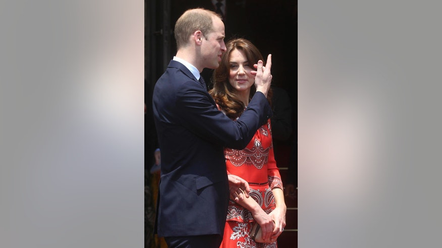 Britain's Prince William, left, along with Kate, the Duchess of Cambridge, talks with staff members at Hotel Taj in Mumbai, India, Sunday, April 10, 2016. The British royal couple visited this iconic hotel which was one of the prime targets of the 2008 terror attacks on the city. (AP Photo/Rafiq Maqbool)