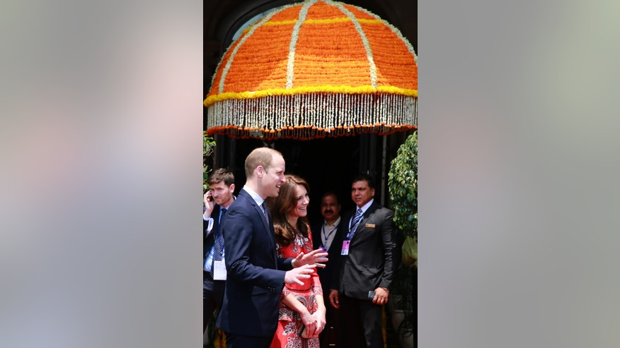 Britain's Prince William, left, along with Kate, the Duchess of Cambridge, speaks to staff members at Hotel Taj in Mumbai, India, Sunday, April 10, 2016. The British royal couple visited this iconic hotel which was one of the prime targets of the 2008 terror attacks on the city. (AP Photo/Rafiq Maqbool)