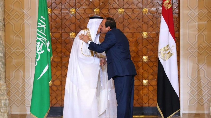 In this picture taken Friday, April 8, 2016, provided by the office of the Egyptian Presidency, Egyptian President Abdel-Fattah el-Sissi, right, greets Saudi Arabia's King Salman in Cairo.  Egypt welcomed Saudi Arabia's monarch on a landmark visit to the Arab world's most populous country on Thursday, with Cairo seeking to boost ties and garner deals to prop up the nation's shaky economy despite some persistent divisions with the Sunni powerhouse. (Mohamed Samaha, Egyptian Presidency via AP)