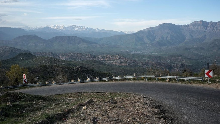 In this picture taken Friday, April 8, 2016, a view of the Zagros mountain range in northern Iraq.  Dozens of villages have been abandoned and hundreds of families displaced close to Iraq's northern border with Turkey as a result of Turkish air strikes targeting militants of the Kurdistan Workers' Party, better known as the PKK. (AP Photo/Alice Martins)