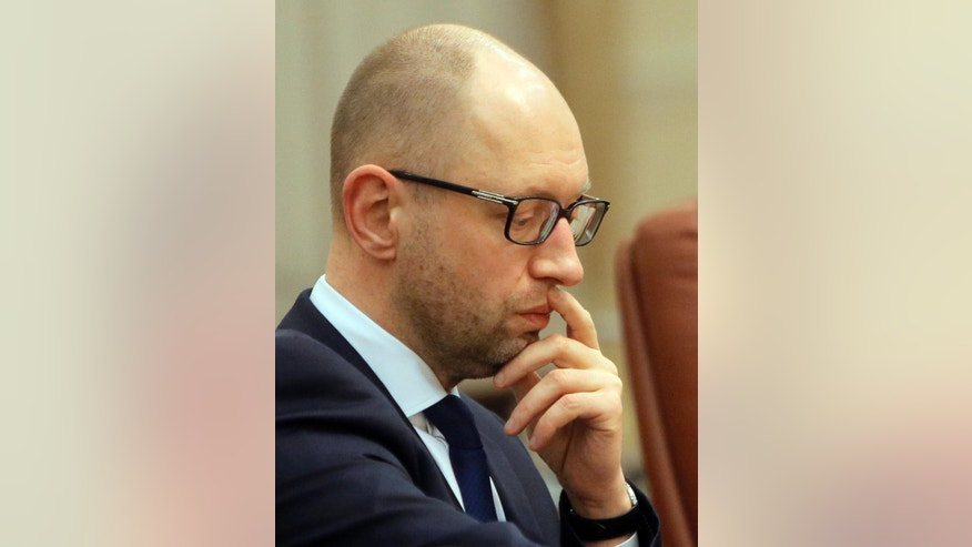 FILE - In this Monday, Feb. 22, 2016 file photo Ukrainian Prime Minister Arseniy Yatsenyuk attends a meeting in Kiev, Ukraine. Ukraine's embattled Prime Minister Arseniy Yatsenyuk says he is resigning, opening the way for the formation of a new government to end a drawn-out political crisis. In his televised address on Sunday, April 10, 2016 Yatsenyuk said his resignation would be formally submitted to parliament on Tuesday. (AP Photo/Efrem Lukatsky, file)