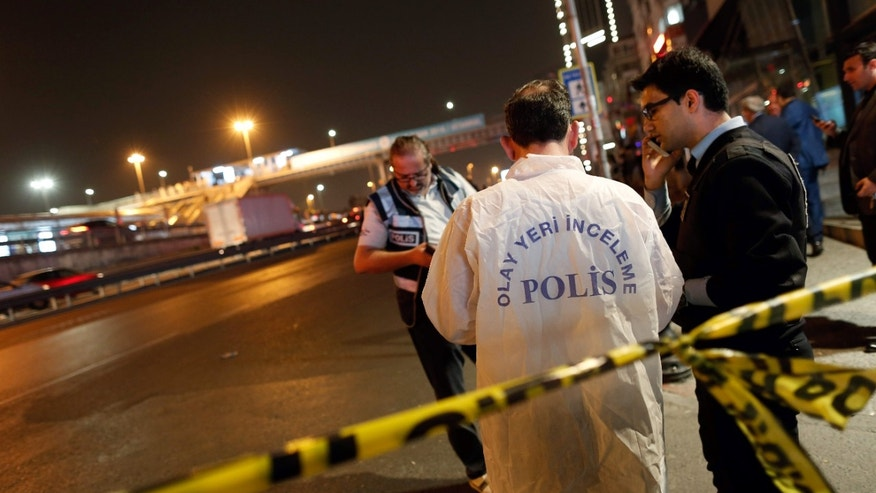 April 9, 2016: Police forensic officers investigate an explosion near an overpass in Istanbul.