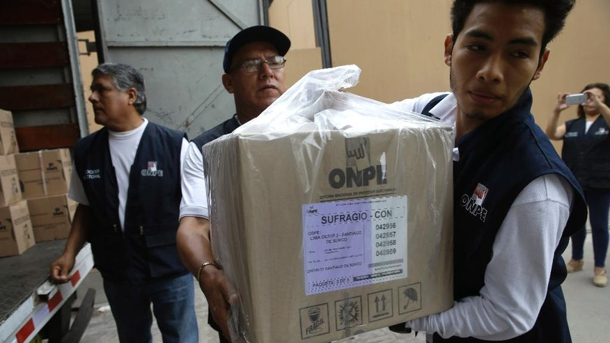 Electoral workers carry voting materials to a polling station, set up inside a public school, in Lima, Peru, Saturday, April 9, 2016. Peru will hold general elections on April 10.  (AP Photo/Martin Mejia)