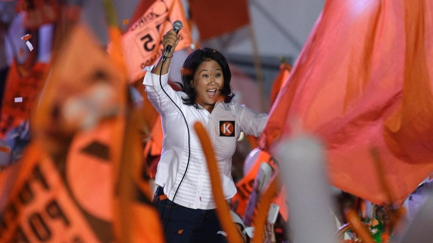 "Presidential candidate Keiko Fujimori, of the ""Fuerza Popular"" political party, waves at supporters during her closing presidential campaign rally, in Lima, Peru, Thursday, April 7, 2016. Keiko, the daughter of former President Alberto Fujimori, is the frontrunner in Peru's upcoming April 10 election. (AP Photo/Martin Mejia)"