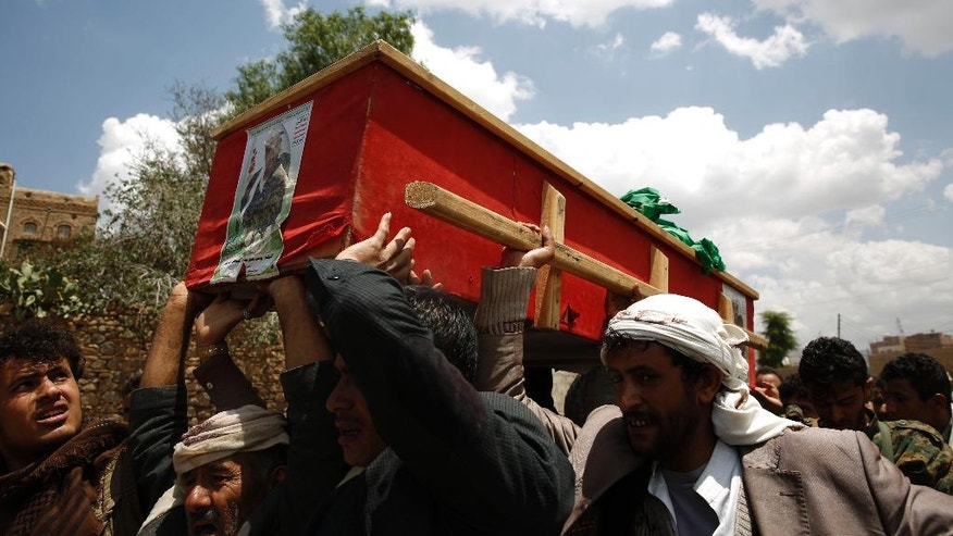 Shiite rebels, known as Houthis, carry the coffin of a fellow Houthi who was killed during fighting against  Saudi-backed Yemeni forces in Marib province, a few hours before the start of a fresh cease-fire in Sanaa, Yemen, Sunday, April 10, 2016. (AP Photo/Hani Mohammed)