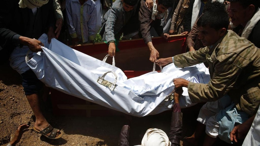 Shiite rebels, known as Houthis, bury the body of a fellow Houthi, who was killed during fighting against  Saudi-backed Yemeni forces in Marib province, a few hours before the start of a fresh cease-fire in Sanaa, Yemen, Sunday, April 10, 2016. (AP Photo/Hani Mohammed)