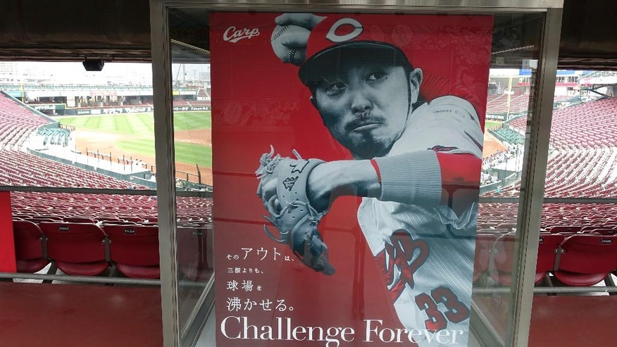 In this Sunday, April 10, 2016 photo, a poster of Hiroshima Toyo Carp's infielder Ryosuke Kikuchi is displayed at the team's home stadium in Hiroshima, western Japan. The homegrown baseball club is the only team not owned by a big corporation in Japan's professional baseball, comprised of 12 teams divided between the Pacific and the Central Leagues. This year's two-day Group of Seven foreign ministers' meeting started here Sunday. (AP Photo/Mari Yamaguchi)