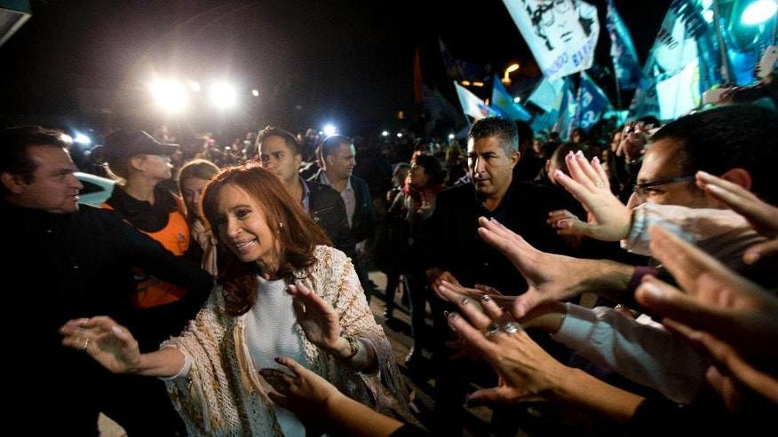 Former Argentina's President Cristina Fernandez, left,  is greeted by followers upon her arrival at the airport in Buenos Aires, Argentina, Monday, April 11, 2016. After spending  four months in Patagonia, Fernandez' supporters gave her a hero's welcome at a Buenos Aires airport before she faces a court over her possible role in an alleged scheme to manipulate the country's currency.(AP Photo/Natacha Pisarenko)