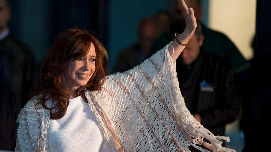 Former Argentina's President Cristina Fernandez waves to supporters upon her arrival at the airport in Buenos Aires, Argentina, Monday, April 11, 2016.  Fernandez' supporters gave her a hero's welcome at a Buenos Aires airport at her arrival after she spent four month in Patagonia before she faces a court over her possible role in an alleged scheme to manipulate the country's currency.(AP Photo/Natacha Pisarenko)