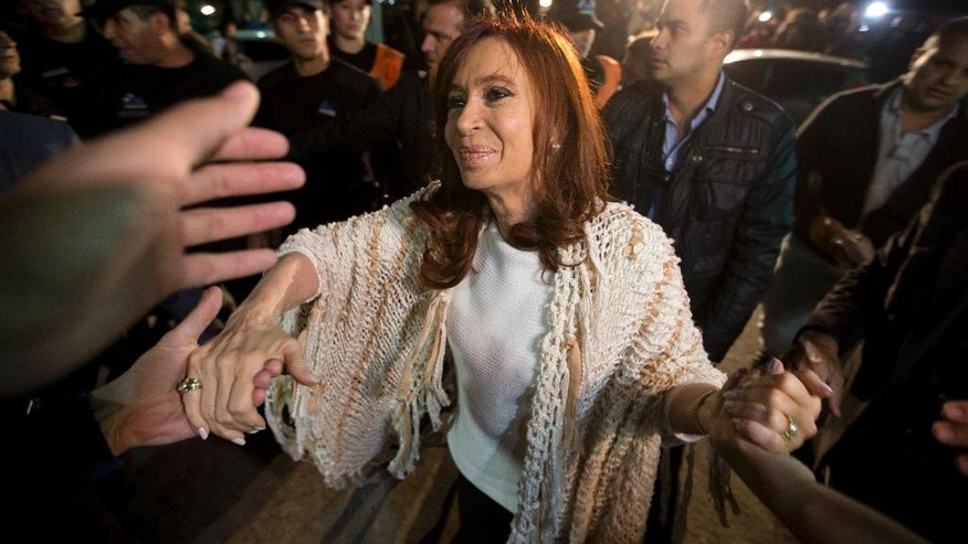 Former Argentina's President Cristina Fernandez is greeted by followers upon her arrival at the airport in Buenos Aires, Argentina, Monday, April 11, 2016. After spending  four months in Patagonia, Fernandez' supporters gave her a hero's welcome at a Buenos Aires airport before she faces a court over her possible role in an alleged scheme to manipulate the country's currency.(AP Photo/Natacha Pisarenko)