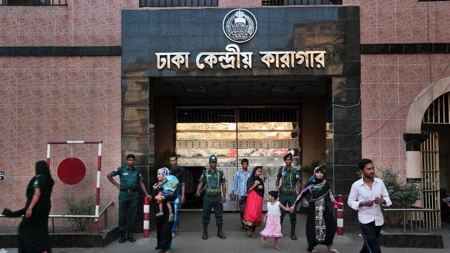 In this April 10, 2016 photo, Bangladeshi security personnel stand guard at the entrance to the Dhaka Central Jail, as visitors walk out after meeting their relatives and friends lodged inside, in Dhaka, Bangladesh. The government wants to reopen the old, dilapidated Dhaka Central Jail as a museum to its tumultuous past, while giving its inmates better accommodations on the outskirts of Dhaka, the capital. The new jail will have an uninterrupted power supply, a 200-bed hospital and a job training center. (AP Photo/ A.M. Ahad)