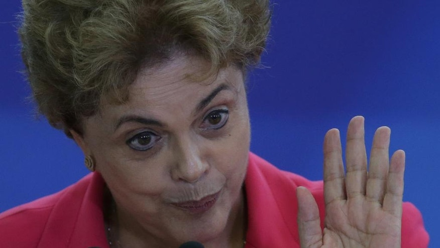 Brazil's President Dilma Rousseff speaks during a Women in Defense of Democracy Meeting, at the Planalto Presidential Palace, in Brasilia, Brazil, Thursday, April 7, 2016. The women representing social movements and trade unions, and are against Rousseff's removal from office, gathered to show her their support. The special investigator for a congressional commission recommended Wednesday that the impeachment process against Rousseff move forward, saying there is evidence she violated fiscal laws. (AP Photo/Eraldo Peres)