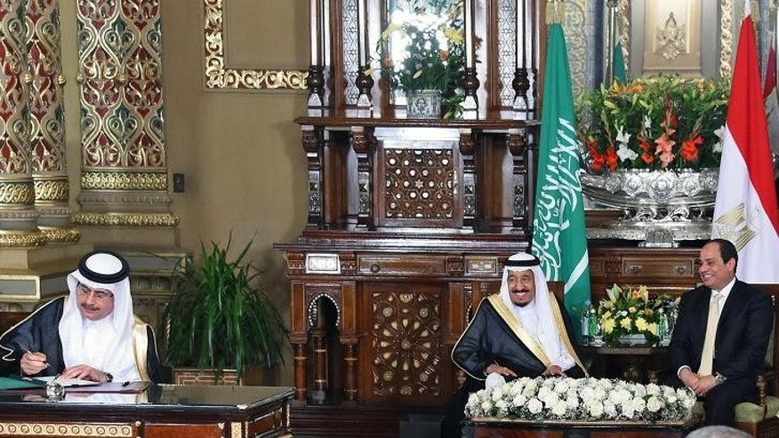 In this picture taken Saturday, April 9, 2016, provided by the office of the Egyptian Presidency, Egyptian President Abdel-Fattah el-Sissi, center right, and Saudi Arabia's King Salman, center left, witness the signing of agreements and memorandums of understanding, in Cairo, Egypt. Egypt welcomed Saudi Arabia's monarch on a landmark visit to the Arab world's most populous country on Thursday, with Cairo seeking to boost ties and garner deals to prop up the nation's shaky economy despite some persistent divisions with the Sunni powerhouse. (Egyptian Presidency via AP)