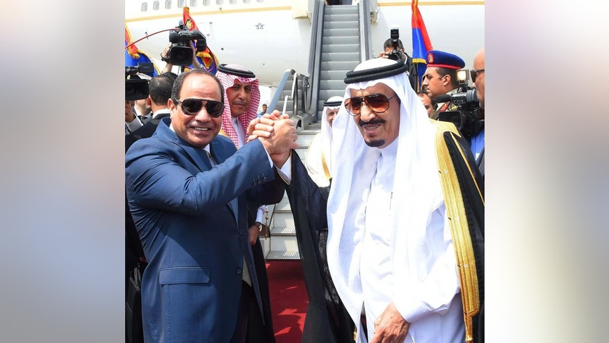 "In this picture provided by the office of the Egyptian Presidency, Egyptian President Abdel-Fattah el-Sissi, left, shakes hands with Saudi Arabia's King Salman before he departs Egypt, Monday, April 11, 2016. Egypt's oldest secular university on Monday granted King Salman of Saudi Arabia an honorary doctorate for his ""unique services"" to Arabs and Muslims, the final function in a five-day visit clouded by opposition to Cairo's intention to hand over control of two Red Sea islands to Riyadh.  (Sherif Abdel Minoem, Egyptian Presidency via AP)"