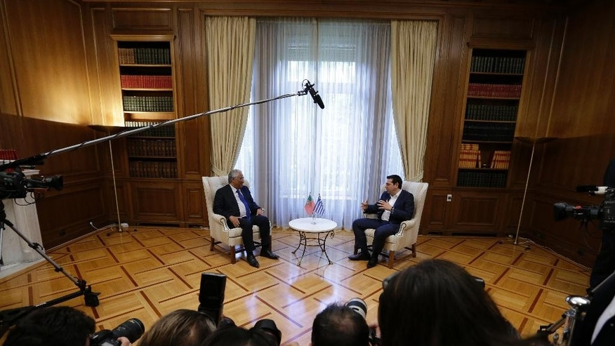 Greece's Prime Minster Alexis Tsipras, right, speaks with his Portuguese counterpart Antonio Costa at the Maximos Mansion in Athens on Monday, April 11, 2016. The two Prime Ministers will sign joint declaration on the future of Europe and further cooperation between Greece and Portugal. Last February Costa informed the EU leaders that Portugal is ready to receive up to 6,000 refugees from Greece in addition to those it has already agreed to receive. (AP Photo/Thanassis Stavrakis)