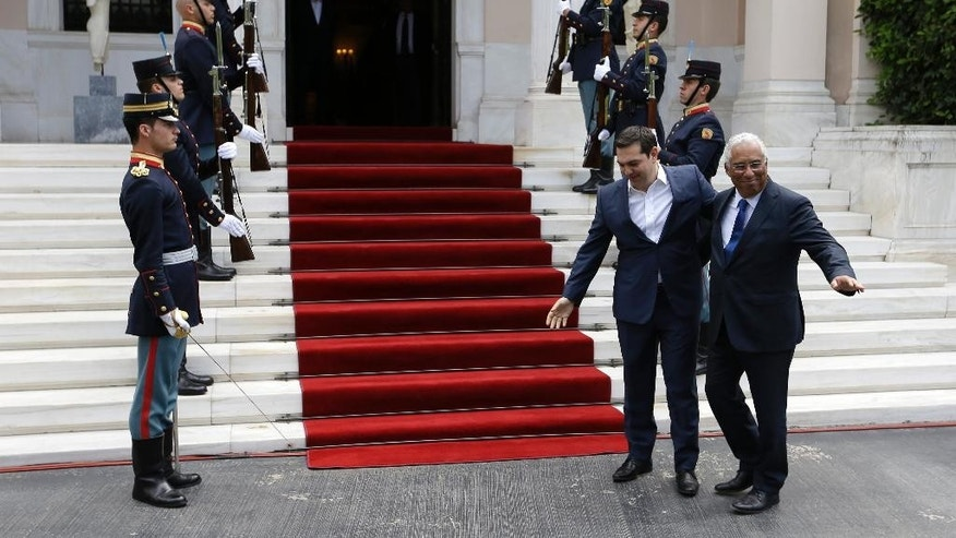 Greece's Prime Minster Alexis Tsipras, second right, welcomes his Portuguese counterpart Antonio Costa at the Maximos Mansion in Athens on Monday, April 11, 2016. The two Prime Ministers will sign joint declaration on the future of Europe and further cooperation between Greece and Portugal. Last February Costa informed the EU leaders that Portugal is ready to receive up to 6,000 refugees from Greece in addition to those it has already agreed to receive. (AP Photo/Thanassis Stavrakis)