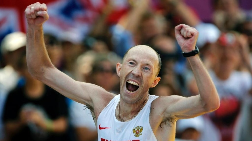 FILE - This is a Saturday, Aug. 11, 2012  file photo of Russia's Sergei Kirdyapkin  as hecelebrates winning the men's 50-kilometer race walk at the 2012 Summer Olympics in London. Sergei Kirdyapkin, Olga Kaniskina and Elena Lashmanova were all named in an updated team list on the Russian Sports Ministry website Monday, April 11, 2016, meaning they could compete at the Olympics in August if the Russian team's suspension from global track and field is lifted in time. (AP Photo/Emilio Morenatti, File)