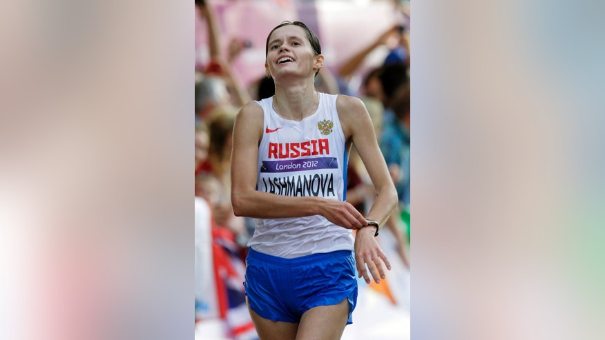 FILE - In this Saturday, Aug. 11, 2012 file photo Elena Lashmanova of Russia makes her way in the 20-kilometer women's race walk at the 2012 Summer Olympics, in London.  Elena Lashmanova,  Sergei Kirdyapkin,  and Olga Kaniskina were all named in an updated team list on the Russian Sports Ministry website Monday, April 11, 2016, meaning they could compete at the Olympics in August if the Russian team's suspension from global track and field is lifted in time. (AP Photo/Dmitry Lovetsky, File)