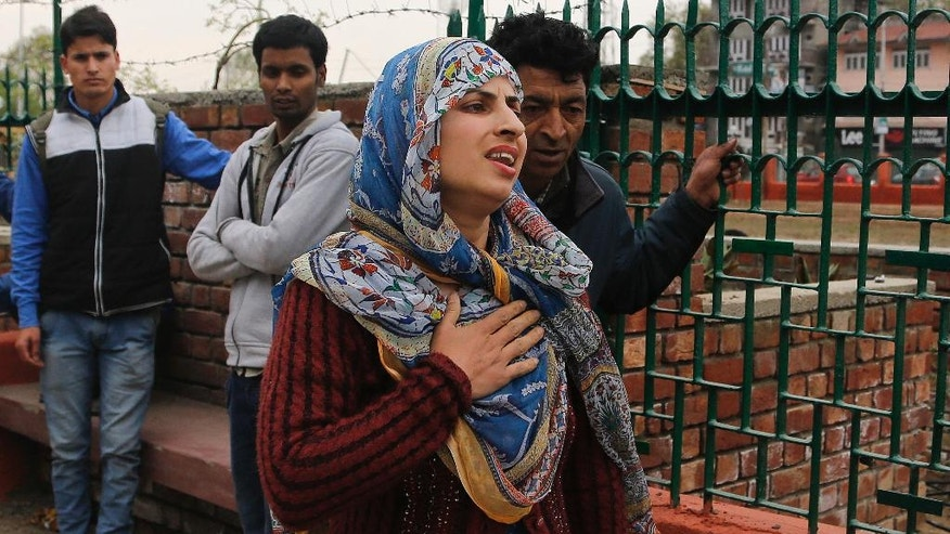 A Kashmiri woman reacts as people stand on a pavement following tremors in Srinagar, Indian controlled Kashmir, Sunday, April. 10, 2016. A powerful earthquake rattled Pakistan's capital and other cities across the country on Sunday, causing panic among people but with no immediate reports of casualties or major damages.Pakistani official Arif Ullah told The Associated Press that the magnitude-7.1 quake was centered near Afghanistan's border with Tajikistan. Germany's GFZ Research Center for Geosciences set the quake's magnitude at 6.5.(AP Photo/Mukhtar Khan)