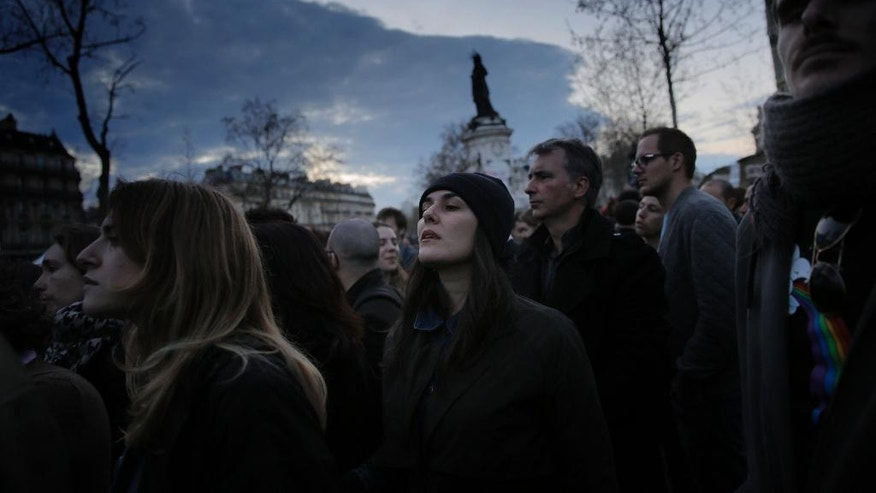 "People gather on the Place de la Republique, Sunday, April 10, 2016. Thousands of protesters have been camping out, holding night-time demonstrations since last week at a symbolic rallying point on the Place de la Republique, to express anger at a proposed labor law and social conditions in France. The social media-driven movement, called ""Nuit Debout"" or ""Rise up at Night,"" sprang from nationwide strikes and protests last week. (AP Photo/Christophe Ena)"
