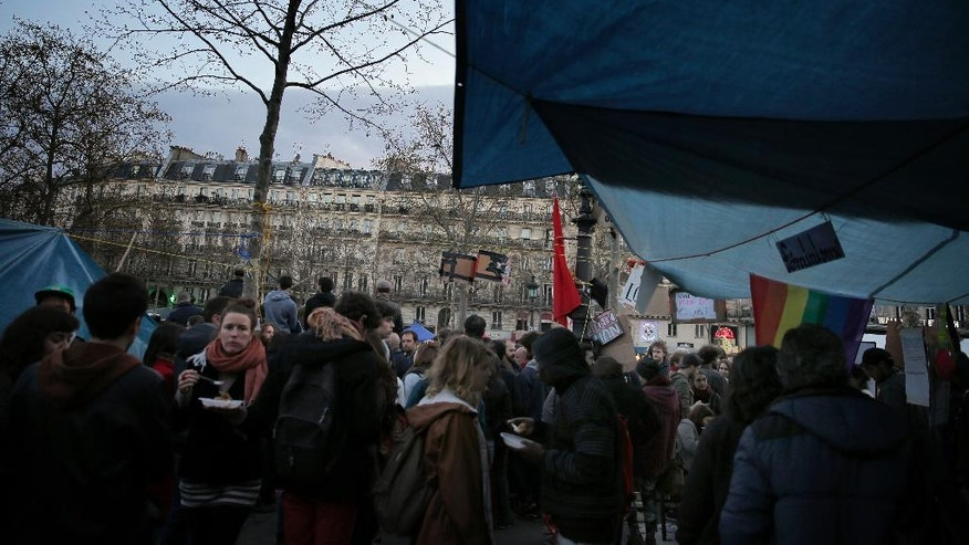 "People gather nest tents on the Place de la Republique, Sunday, April 10, 2016. Thousands of protesters have been camping out, holding night-time demonstrations since last week at a symbolic rallying point on the Place de la Republique, to express anger at a proposed labor law and social conditions in France. The social media-driven movement, called ""Nuit Debout"" or ""Rise up at Night,"" sprang from nationwide strikes and protests last week. (AP Photo/Christophe Ena)"