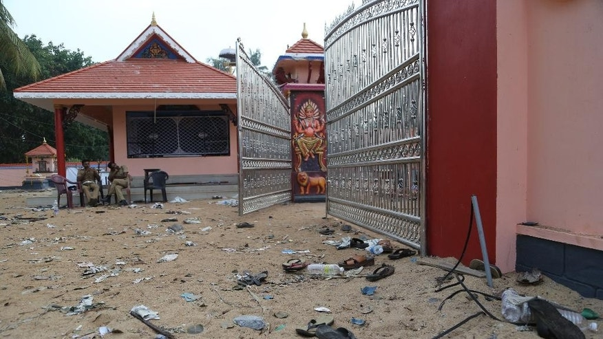 April 11, 2016: Footwear of the devotees lie scattered inside the temple compound where a massive fire broke out during a fireworks display at the Puttingal temple complex in Paravoor village, Kollam district, southern Kerala state, India.