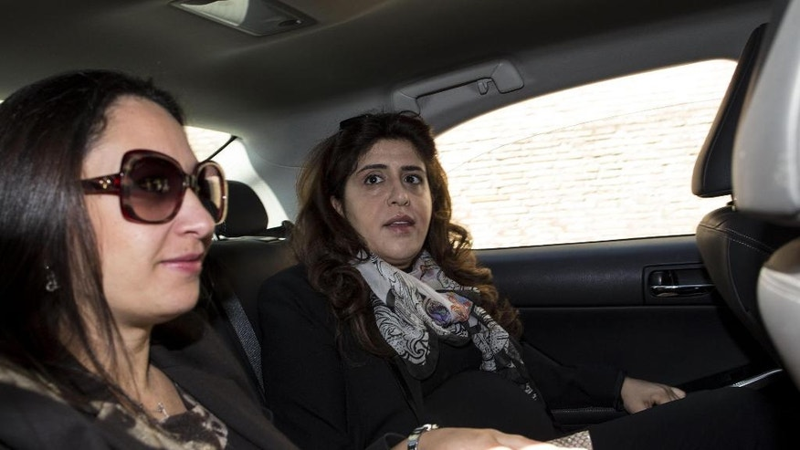 Public relations expert Francesca Chaouqui, right, is accompanied by her lawyer Laura Sgro' as she arrives at the Vatican for her trial, Monday, April 11, 2016. Two Italian journalists who wrote books detailing Vatican mismanagement face trial in a Vatican courtroom along with three people accused of leaking them the information in a case that has drawn scorn from media watchdogs. (Massimo Percossi/ANSA via AP)