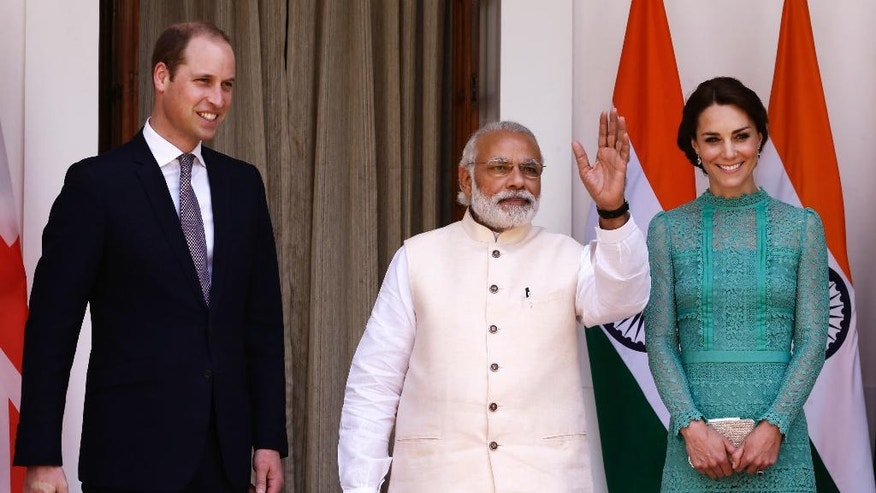 Britain's Prince William, left, and his wife Kate, the Duchess of Cambridge, right, are greeted by Indian Prime Minister Narendra Modi as they arrive for a lunch with him, in New Delhi, India, Tuesday, April 12, 2016. The Duke and Duchess of Cambridge are on a weeklong visit to India, their first royal tour in two years.  (AP Photo/Saurabh Das)