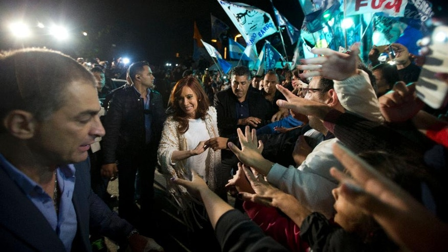 Former Argentina's President Cristina Fernandez gets a hero's welcome by a group of supporters as arrives at the airport in Buenos Aires, Argentina, Monday, April 11, 2016.  Fernandez spent four month in Patagonia before facing a court over her possible role in an alleged scheme to manipulate the country's currency.(AP Photo/Natacha Pisarenko)