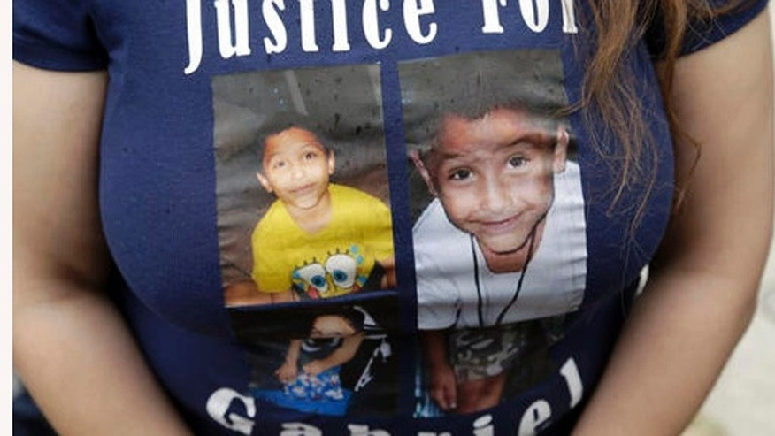 A friend of the family of Gabriel Fernandez, wears a shirt with his likeness Thursday, April 7, 2016.