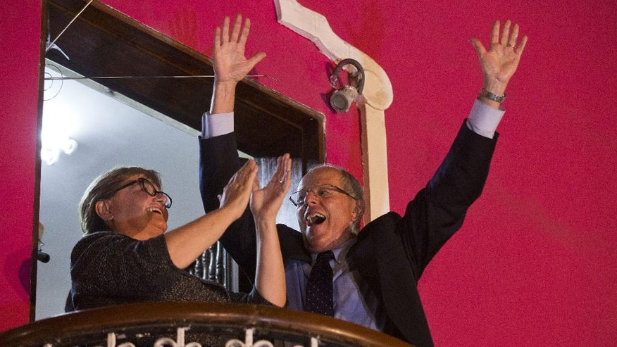 "Presidential candidate Pedro Pablo Kuczynski of the ""Peruanos por el Kambio"" political party and his wife Nancy Lange, celebrate the first official results that place him in second place in the elections, in Lima, Peru, Sunday, April 10, 2016. Early official results in Peru's presidential election point to Keiko Fujimori, the daughter of jailed former President Alberto Fujimori emerging as the winner of the first round. Keiko Fujimori will likely face Kuczynski in a June runoff. (AP Photo/Esteban Felix)"