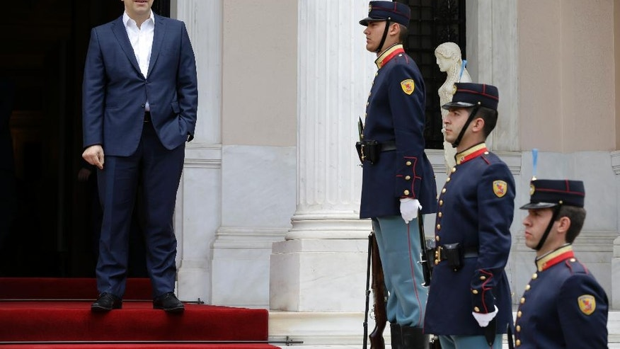 Greece's Prime Minster Alexis Tsipras, left, waits for his Portuguese counterpart Antonio Costa at the Maximos Mansion in Athens on Monday, April 11, 2016. Greek officials and representatives of the country's bailout creditors will have another go at overcoming disagreements on austerity measures, after all-night talks failed to produce a breakthrough. Greece has depended on rescue loans since 2010, and signed a third, 86-billion-euro ($98-billion) bailout deal last summer. (AP Photo/Thanassis Stavrakis)