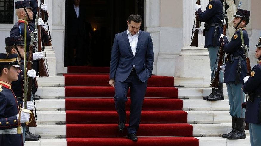 Greece's Prime Minster Alexis Tsipras waits his Portuguese counterpart Antonio Costa at the Maximos Mansion in Athens on Monday, April 11, 2016. Greek officials and representatives of the country's bailout creditors will have another go at overcoming disagreements on austerity measures, after all-night talks failed to produce a breakthrough. Greece has depended on rescue loans since 2010, and signed a third, 86-billion-euro ($98-billion) bailout deal last summer. (AP Photo/Thanassis Stavrakis)