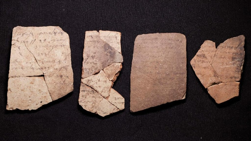 Letters inscribed on pottery, known as ostracons, which were unearthed in an excavation of a fort in Arad, Israel, and dated to about 600 B.C. shortly before Nebuchadnezzar's destruction of Jerusalem, are seen in Israel Museum in Jerusalem Tuesday, April 12, 2016.  A Tel Aviv University team determined that this famous hoard of ancient Hebrew inscriptions was written by at least six different authors. Although the inscriptions are not from the Bible, their discovery suggests there was widespread literacy in ancient Judah at the time that would support the composition of biblical works.  (AP Photo/Dan Balilty)