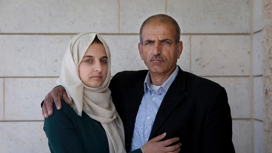 Ismail al-Wawi, 54, right and Ghayda al-Wawi, 17, the father and sister of the 12-year-old Palestinian girl imprisoned in the stabbing plot.