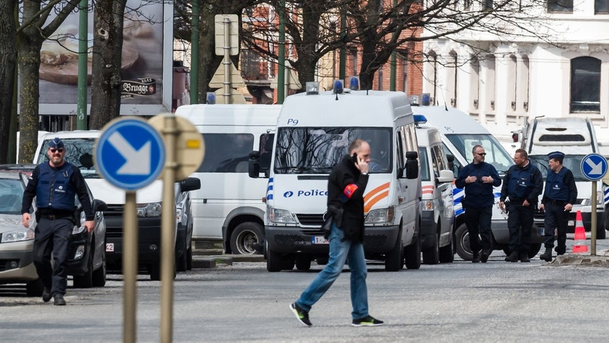 April 9, 2016: Police secure an area during a house search in the Etterbeek neighborhood in Brussels.