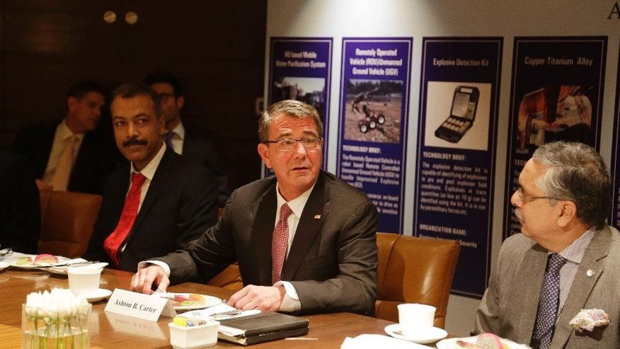 U.S. Defense Secretary Ash Carter, center, speaks at Innovation Roundtable organized by Federation of Indian Chambers of Commerce and Industry, in New Delhi, India, Tuesday, April 12, 2016. (AP Photo/Altaf Qadri)