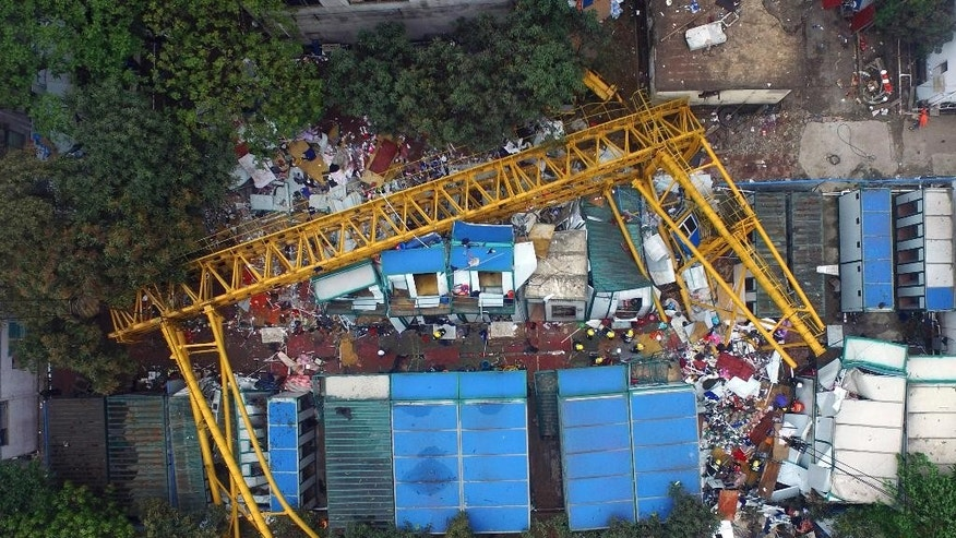 This photo released by China's Xinhua News Agency shows a collapsed temporary structure at an accident site in Dongguan City, south China's Guangdong Province, Wednesday, April 13, 2016. The 80-ton scaffold fell directly onto two-story temporary buildings at the construction site amid a fierce windstorm. (Liang Xu/Xinhua via AP) NO SALES