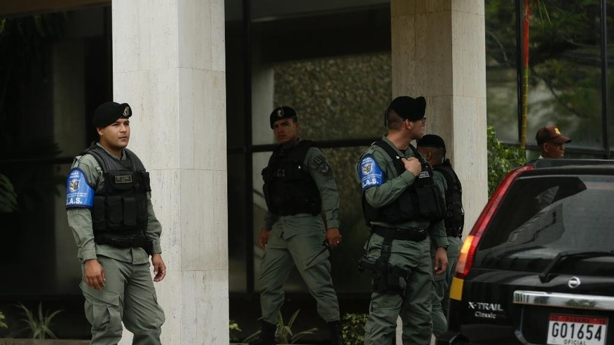 Police officers stand outside Mossack Fonseca law firm while Organized crime prosecutors raid the offices, in Panama City, Tuesday, April 12, 2016. Organized crime prosecutors raided the offices of the Mossack Fonseca law firm Tuesday looking for evidence of money laundering and financing terrorism following a leak of documents about tax havens it set up for wealthy international clients. (AP Photo/Arnulfo Franco)