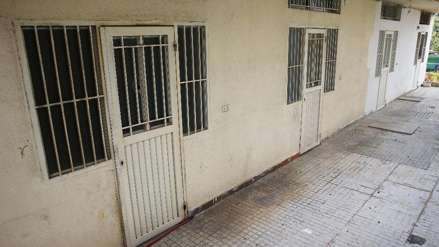 This Thursday April 7, 2016 photo, shows barred rooms of the Chez Maurice Hotel in Maamelteine north of Beirut, Lebanon.  Lebanese security forces have busted a sex trafficking ring involving 75 Syrian women trafficked to Lebanon from their country and forced into prostitution. The women were tortured by their traffickers and locked inside two hotels including the Chez Maurice, until their rescue last month. (AP Photo/Hussein Malla)